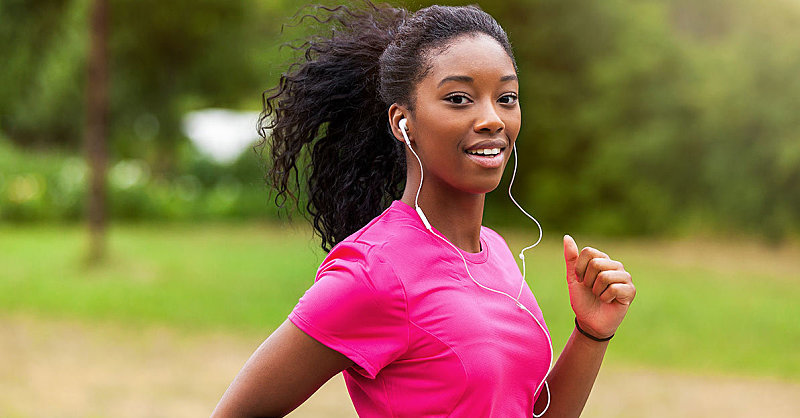 1200_happy-woman-running-with-headphones
